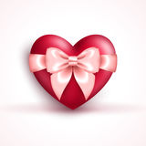 Valentine`s icon - glossy red heart with pink bow Royalty Free Stock Photos