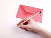 Valentine's letter. I write a valentine's letter / red envelope Royalty Free Stock Photo