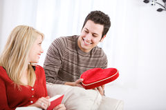 Valentine's: Man Give Candy Heart Box To Girlfriend Royalty Free Stock Image