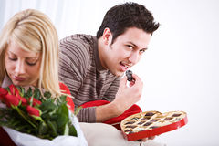 Valentine's: Man Sneaks Candy From Box Stock Photo