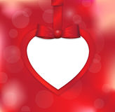 Valentine's paper card on red blurred background with red gift bow and ribbon Royalty Free Stock Photography