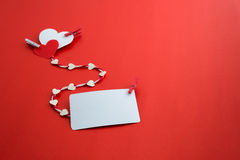 Valentine's paper hearts with a blank business card and Clothesp Royalty Free Stock Photos