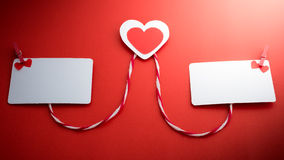 Valentine's paper hearts with a blank business card and Clothesp Royalty Free Stock Photography