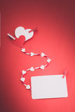 Valentine's paper hearts with a blank business card and Clothesp Stock Photo