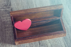 Valentine's red heart in a box. Love concept. Valentine's red heart in a box Royalty Free Stock Images