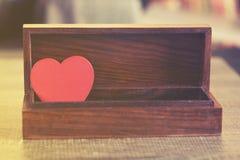 Valentine's red heart in a box. Love concept. Valentine's red heart in a box Royalty Free Stock Photo