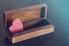 Valentine's red heart in a box. Love concept. Valentine's red heart in a box Royalty Free Stock Photos
