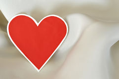 Valentine's red paper heart on silk background Royalty Free Stock Image