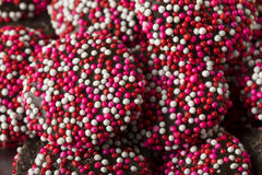 Valentine`s Red and White Chocolate NonPareils Royalty Free Stock Photography