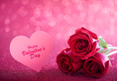 Valentine's Rose. Three red roses over pink glittering background Royalty Free Stock Photo
