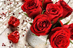 Valentine's setting with bouquet of red roses Stock Images