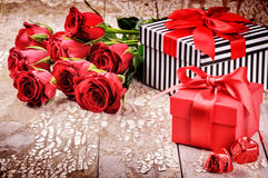 Valentine's setting with bouquet of red roses and presents Royalty Free Stock Photography