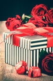 Valentine's setting with red roses and retro gift box Stock Image