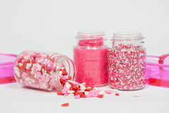 Valentine's Sprinkles with glass hearts Royalty Free Stock Photo
