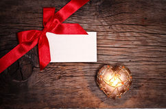Valentine`s still life. Valentine`s card with bow and candle on wood background royalty free stock photography