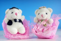 White teddy bear couple in love. The valentine`s theme - white teddy bear couple in love royalty free stock image