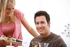 Valentine's: Woman Serving Dinner To Man Stock Images