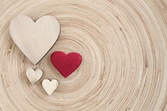 Valentine's wooden hearts on a wooden background Royalty Free Stock Image