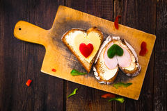 Valentine sandwiches breakfast lovers wooden Royalty Free Stock Images
