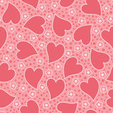 Valentine Seamless background. Abstract Valentine seamless pattern with decorative pink hearts anf flowers Stock Image