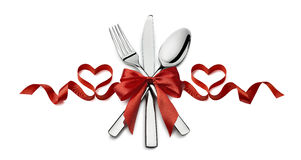 Valentine silverware red ribbon heart restaurant isolated on whi stock photography