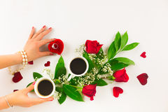 Valentine still life with pearl ring in man hand, red roses and woman hand with coffee. Marriage proposal with pearl ring in man hand, red roses and woman hand Royalty Free Stock Image