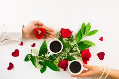 Valentine still life with pearl ring in man hand, red roses and woman hand with coffee. Marriage proposal with pearl ring in man hand, red roses and woman hand Royalty Free Stock Photos