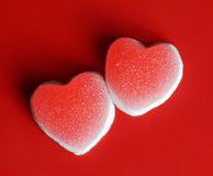 Sugar hearts on red background Stock Image