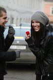 Valentine Surprise. Young man offering a ring in a gift box to a girl Royalty Free Stock Photos
