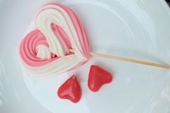Valentine Sweet candy dessert : Meringues and Thai Deletable imitation fruits or Ball plated dessert design in heart shape on whit stock photos