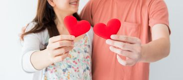 Valentine and Sweetest day, red heart on couple hands. In love stock photo