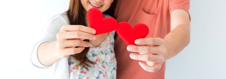 Valentine and Sweetest day, red heart on couple hands. In love royalty free stock image