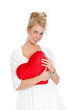 Valentine sweetheart. Pretty blond girl with big red heart on white background Stock Image