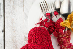 Valentine table setting in gold and red tone on wooden table Stock Photography