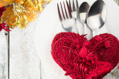 Valentine table setting in gold and red tone on wooden table Royalty Free Stock Photos