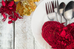 Valentine table setting in gold and red tone on wooden table Royalty Free Stock Photography