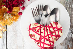 Valentine table setting in gold and red tone on wooden table Royalty Free Stock Image