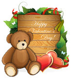 Valentine teddy bear with  hearts and foliage Royalty Free Stock Photos