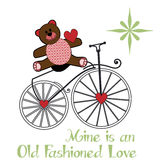 Valentine teddybear sitting on an old fashion bike Stock Photos