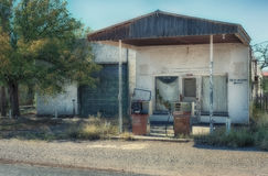 Valentine Texas Abandoned Gas Station with Pumps. Abandoned gas station with pumps and rest rooms sign found in Valentine Texas in far West Texas royalty free stock images