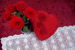 Valentine Themed Background With Heart-shaped Chocolate Box and Red Rose Bouquet on Red Crushed Velvet Background. Valentine themed background with red leather Royalty Free Stock Photos