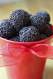 Valentine Truffles. Chocolate truffles in a red bucket Royalty Free Stock Photos