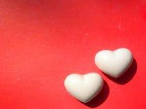Valentine twee hartenachtergrond Stock Foto's