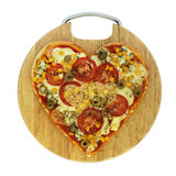 Valentine vegetarian pizza - pizza in the shape of heart Stock Photography