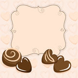 Valentine vignette with chocolate hearts Stock Images