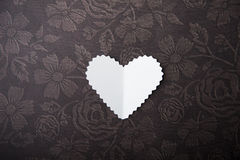 Valentine, white heart on a chocolate background Stock Image