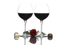 Valentine Wine 3. Two glasses of red wine with a white and dark chocolate truffle. His and her's with a single red rose. To my special Valentine Royalty Free Stock Images