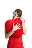 Valentine woman. Beautiful young woman holding a red heart, Valentine concept Royalty Free Stock Photos