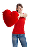 Valentine woman. Beautiful young woman holding a red heart, Valentine concept Royalty Free Stock Images