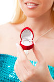 Valentine woman hands with ring in red box. Woman hands with ring in a red heart box, isolated against white background royalty free stock image